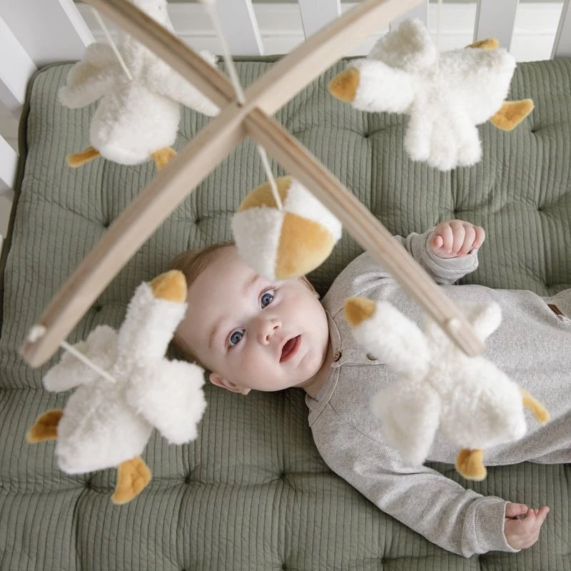 how to hang a mobile over a crib